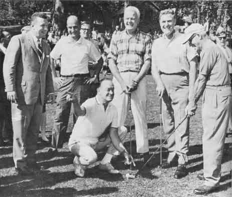 Bob Hope lines up a shot for Charles Tooth, president of the U. S. Blind Golfers Foundation